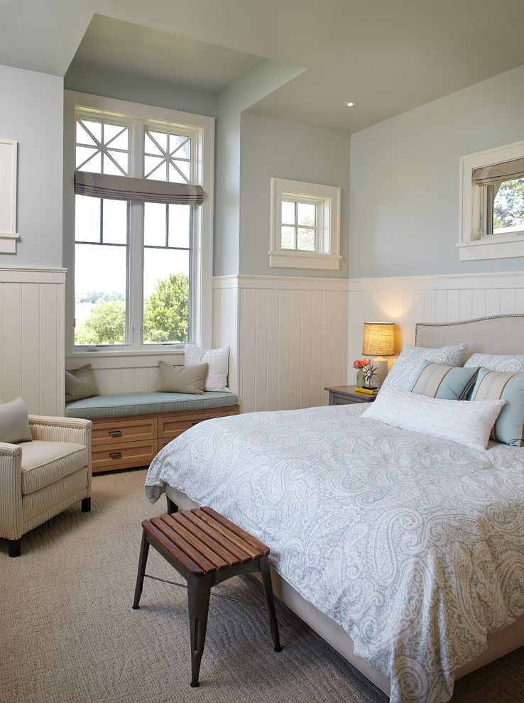 Cream Colored Comforter Sets with Beach Style Bedroom  and Bench Seat Built in Bench Carpeting Light Blue Nailhead Detail Paisley Bedding Storage Drawers Transom Windows Upholstered Bed Wainscoting White Casing Window Seat