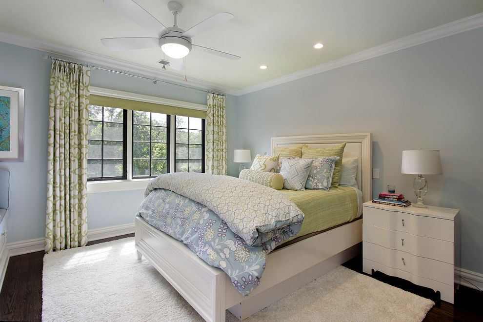 Cream Colored Comforter Sets with Contemporary Bedroom Also Baseboards Bed Pillows Bedside Table Ceiling Fan Crown Molding Curtains Drapes Light Blue Walls Nightstand White Bedroom Furniture White Rug White Trim Window Treatments Wood Floors