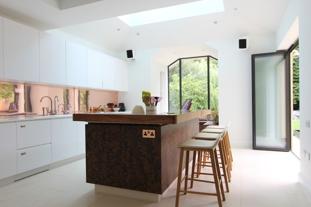 Crippen Sheet Metal   Contemporary Kitchen  and Airy Breakfast Bar Stools Bright and Airy Home Copper Backsplask Frosted Glass Door Geometric Shaped Windows Kitchen Island Kitchen Skylight Open Floor Plan Open Plan Living Skylight Wooden Worktop