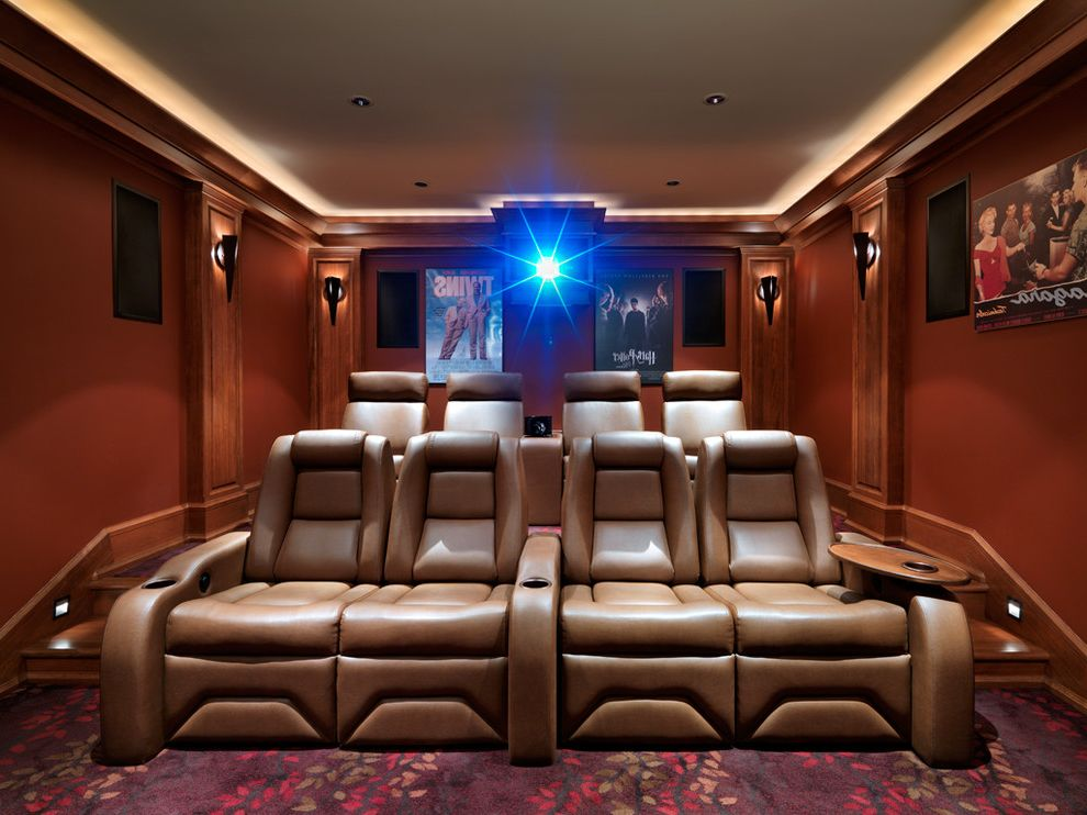 Crown Point Theater   Craftsman Home Theater  and Baseboards Cove Lighting Home Theater Movie Posters Projector Recessed Lighting Reclining Chairs Red Walls Sconce Screening Room Stadium Seating Wall Lighting