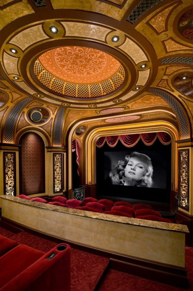 Crown Point Theater   Mediterranean Home Theater Also Cove Lighting Home Theater Movie Theater Private Home Movie Theater Recessed Lighting Red Arm Chairs