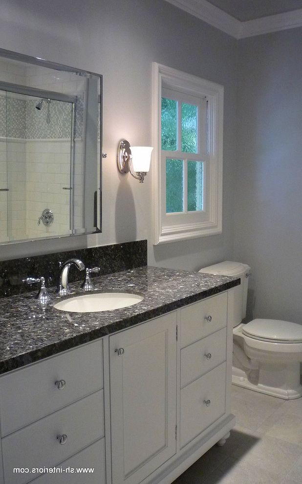 Daltile Van Nuys with Traditional Bathroom  and Blue Blue Pearl Granite Budget Bathrooms Chrome Granite Counters Sink Vanity Subway Tile Traditional Bathroom Traditional Vanity Transitional