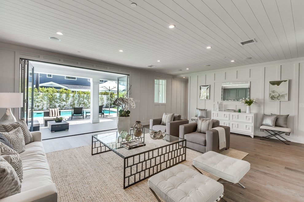Daltile Van Nuys with Transitional Living Room  and Beige Sisel Rug Beige Sofa Black Coffee Table Indoor Outdoor Shiplap Ceiling Shiplap Walls White Leather Ottoman