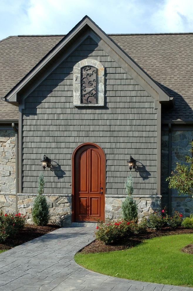 Dark Brown Vinyl Siding   Eclectic Entry  and Entry Front Door Gray Iron Work Landscaping Lawn Lighting Outdoor Sconce Shingle Stone