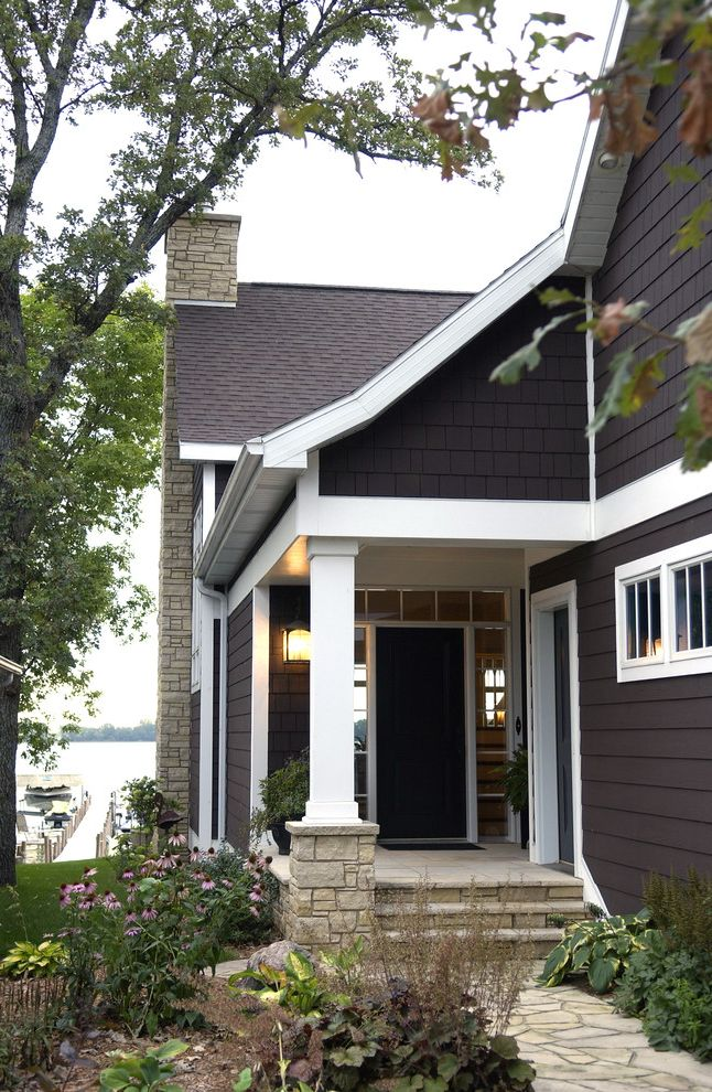 Dark Brown Vinyl Siding   Traditional Porch  and Brown Siting Chimney Coneflowers Covered Entry Flagstone Garden Heuchera Path Porch Shingles Side Door Side Lites Stacked Stone Stone Path Transom Water View White Trim