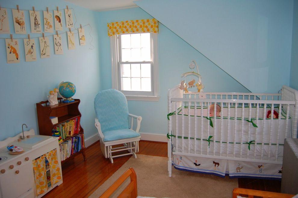 Davinci Highland Crib with Eclectic Nursery  and Area Rug Baseboard Blue Wall Bookcase Clothesline Crib Crib Bedskirt Glider Chair Mobile Nursery Playroom Valance Wall Art Wall Decor Wood Flooring