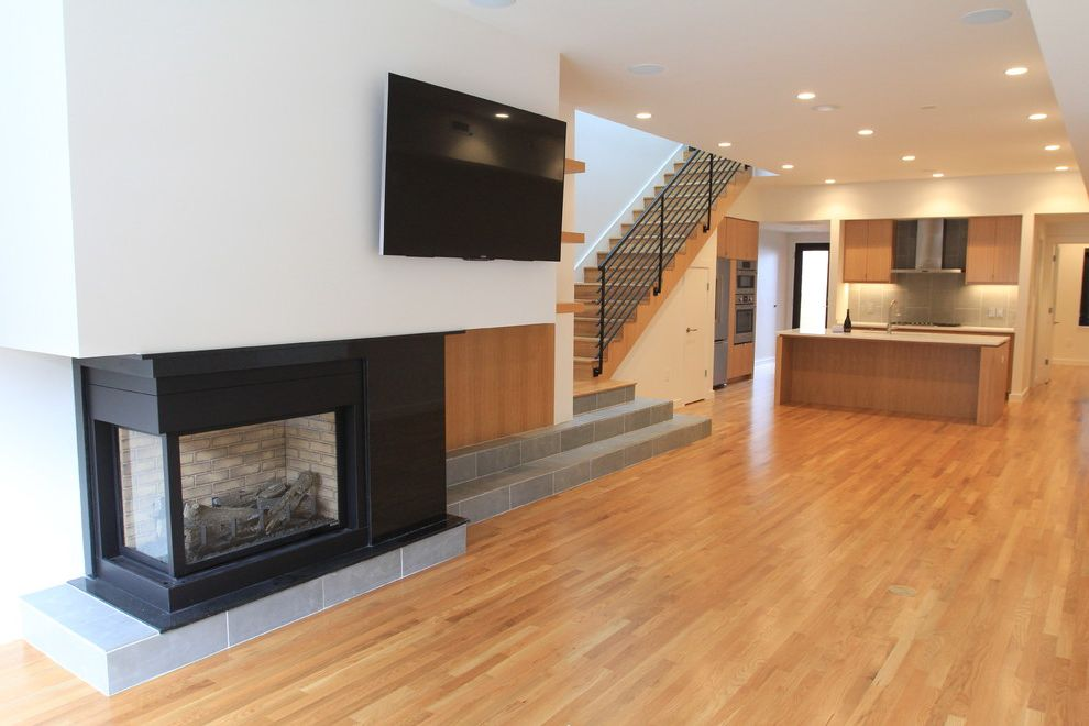 Davis and Green Electrical   Modern Family Room  and Electric Fireplaces Electrical Contracting Electrical Design Electrical Services Modern Single Family Residential
