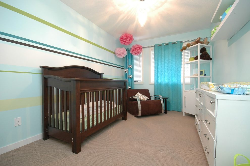 Deans Carpet with Modern Nursery and Baseboards Blue Walls Carpet Changing Table Chest of Drawers Dark Wood Crib Dresser Lighing Nursery Paint Colours Storage Striped Walls Tissue Pom Poms Wall Stripes
