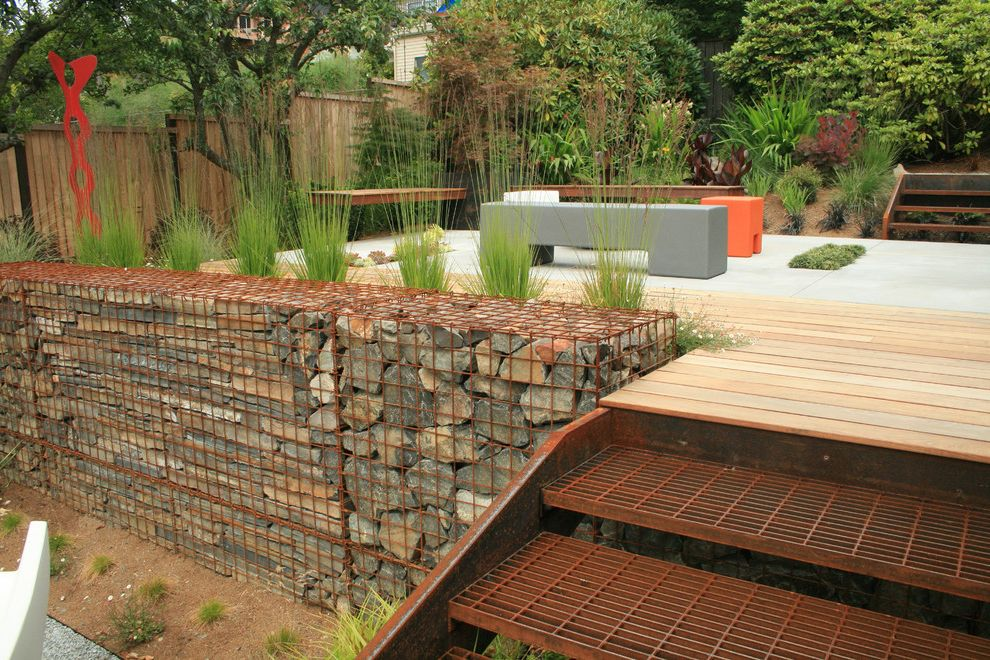 Deck Cost Estimator   Industrial Deck Also Contemporary Deck Gabion Wall Grasses Gray Bench Ipe Landscape Metal Stairs Modern Bench Modern Outdoor Furniture Patio Red Sculpture Rock Rockery Rust Steel Stone Wood Fence