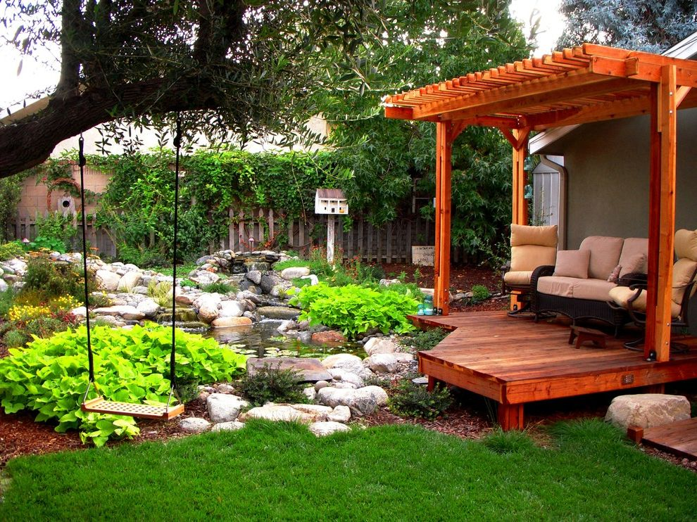 Deck Swings with Canopy   Traditional Landscape Also Aquatic Garden Backyard Birdhouse Boulders Chartreuse Foliage Deck Grass Lawn Pavilion Pergola Pond Rocks Tree Swing Turf Water Feature Water Garden Water Lilies