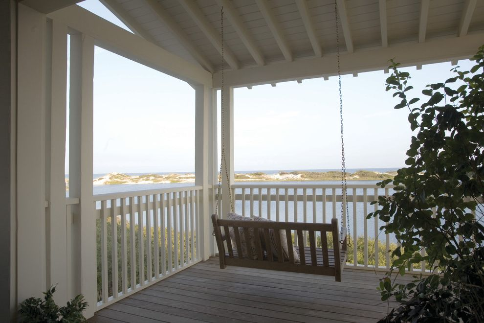 Deck Swings with Canopy   Traditional Porch  and Balustrade Coast Deck Eaves Exposed Beams Handrail Ocean Open Porch Overhang Porch Swing View White Wood Wood Flooring Wood Post Wood Railing
