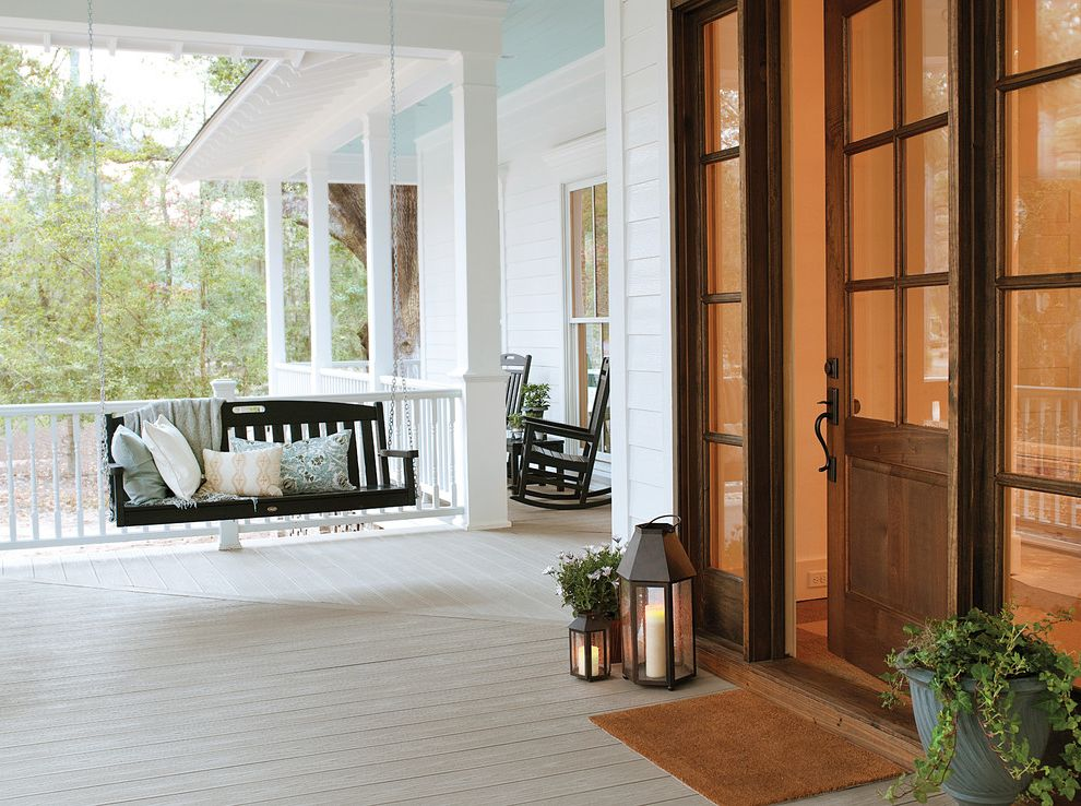 Deck Swings with Canopy   Traditional Porch  and Covered Porch Front Porch Glass Front Door Hanging Porch Swing Lantern Porch Swing Rocking Chair White Beam White Deck Railing White Exterior White House White Post White Siding Wood Deck Wood Front Door