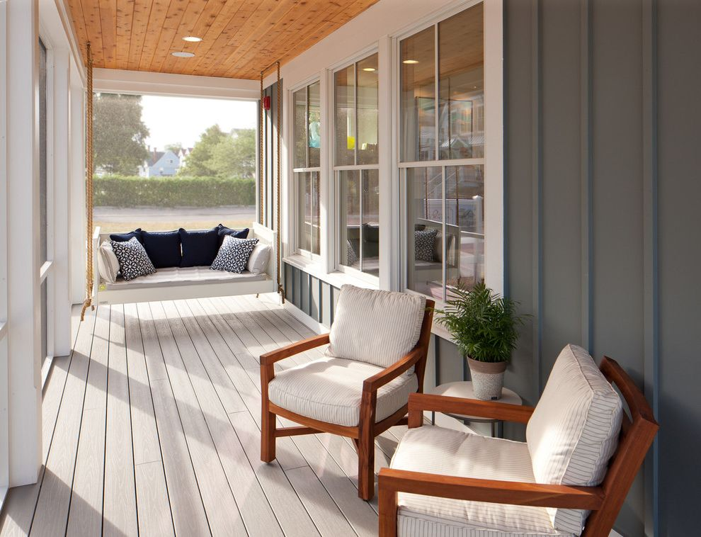Deck Swings with Canopy with Beach Style Porch  and Bench Swing Blue Pillows Board and Batten Gray Exterior Porch Swing Seat Cushions White Casing Wood Ceiling Wood Porch