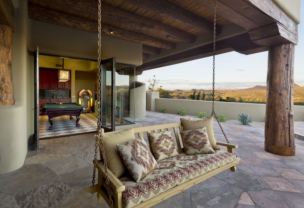 Deck Swings with Canopy with Southwestern Patio  and Corner Window Covered Patio Glass Wall Pavers Stone Stucco Wood Beams