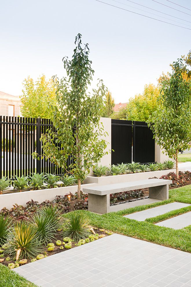 Decorative Chain Link Fence with Contemporary Landscape and Concrete Concrete Bench Concrete Pathway Concrete Planters Concrete Walkway Fence Garden Gate Landscape Planter Box Shrubs