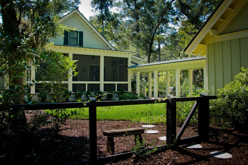 Decorative Chain Link Fence with Farmhouse Exterior and Breezeway Farmhouse Gable Grass Landscape Lawn Lowcountry Mulch Neutral Colors Path Pavers Screen Porch Turf Walkway White Wood Window Shutters Wire Fence Wood Fencing Wood Molding Wood Siding