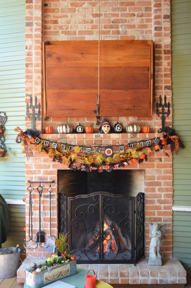 Decorative Fireplace Covers with Traditional Porch  and Brick Fireplace Concealed Tv Fireplace Tool Set Garland Halloween Decor Halloween Decorations Hidden Tv Mantel Decor Metal Fireplace Screen My Houzz Pumpkins Tv Cabinet