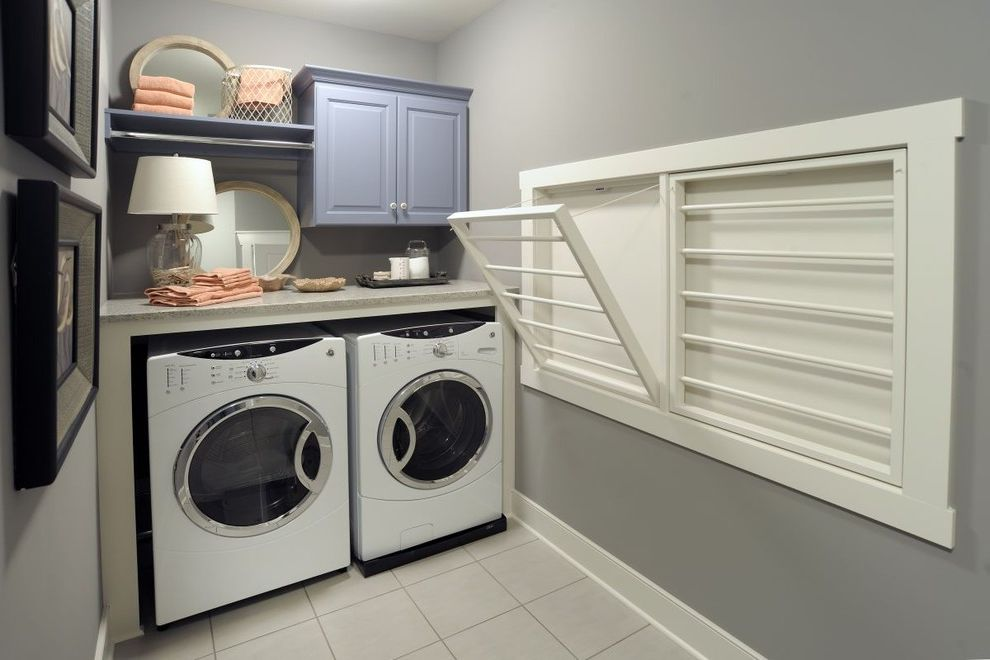 Decorative Garment Rack   Traditional Laundry Room Also Baseboards Drying Rack Front Loading Washer and Dryer Gray Walls Laundry Room White Trim