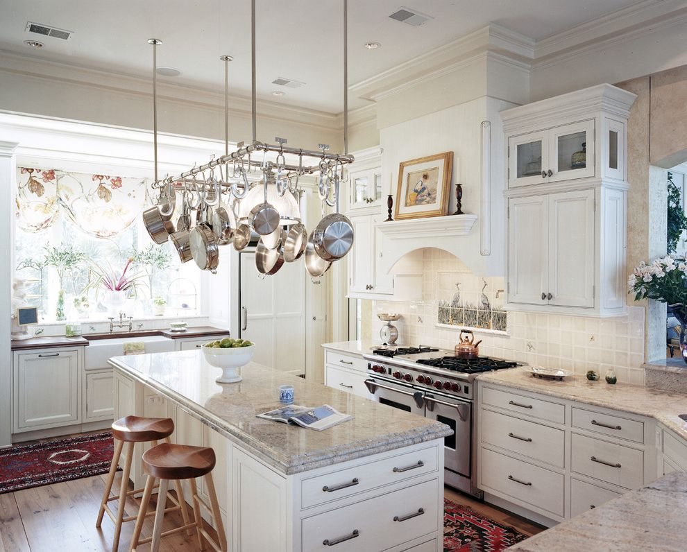 Decorative Garment Rack with Traditional Kitchen Also Decorative Tile Backsplash Farmhouse Sink Glass Front Cabinets Kitchen Island Oriental Rug Pot Rack Professional Range Tractor Stools White Cabinets Wide Plank Floor Window Treatment