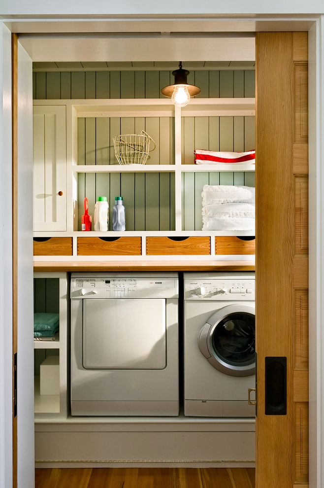 Deep Pocket Flannel Sheets with Beach Style Laundry Room  and Built in Storage Front Loading Washer and Dryer Laundry Room Storage Pendant Lighting Pocket Door Sliding Door White Wood Wood Flooring Wood Molding Wood Paneling