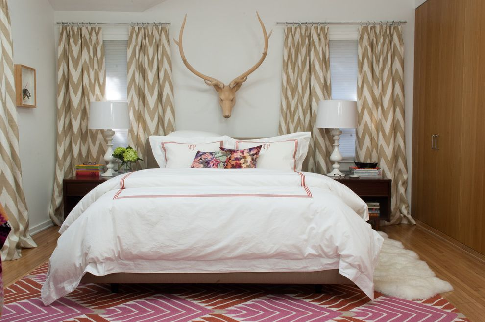 Deer Antler Table Lamps with Eclectic Bedroom  and Antlers Beige Chevron Rug Built in Armoire Built in Closet Dark Wood Nightstand Floral Throw Pillow Fur Rug Pink Accents Pink Patterned Rug White Bedding White Table Lamp White Wall