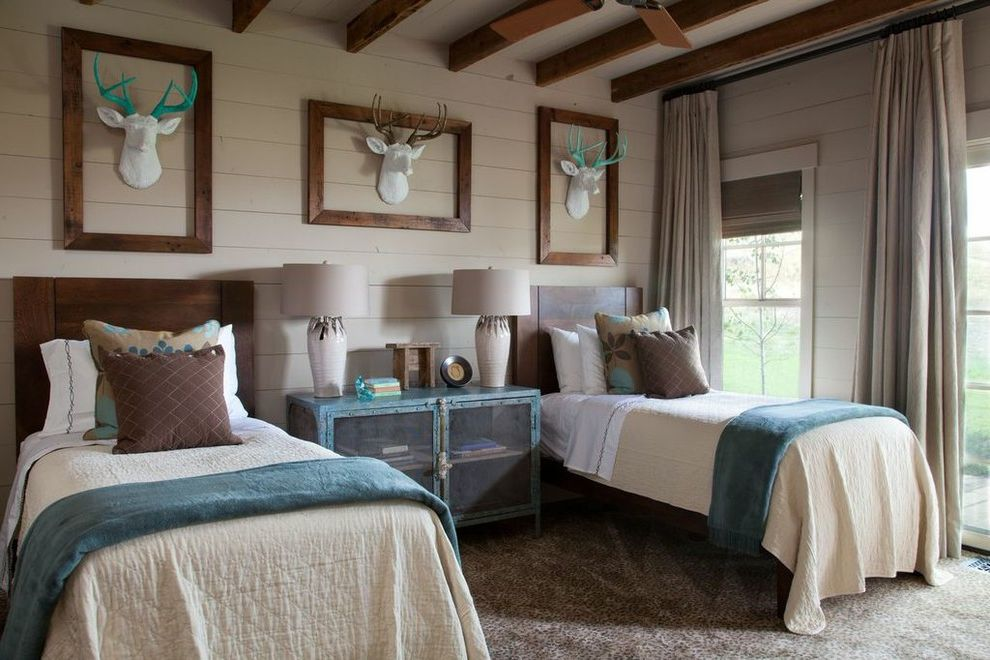 Deer Creek Storage   Rustic Bedroom  and Animal Printed Carpets Blue Velvet Throws Exposed Beams Fake Deer Heads Framed Deer Heads Painted Antlers White Deer Head White Lamps