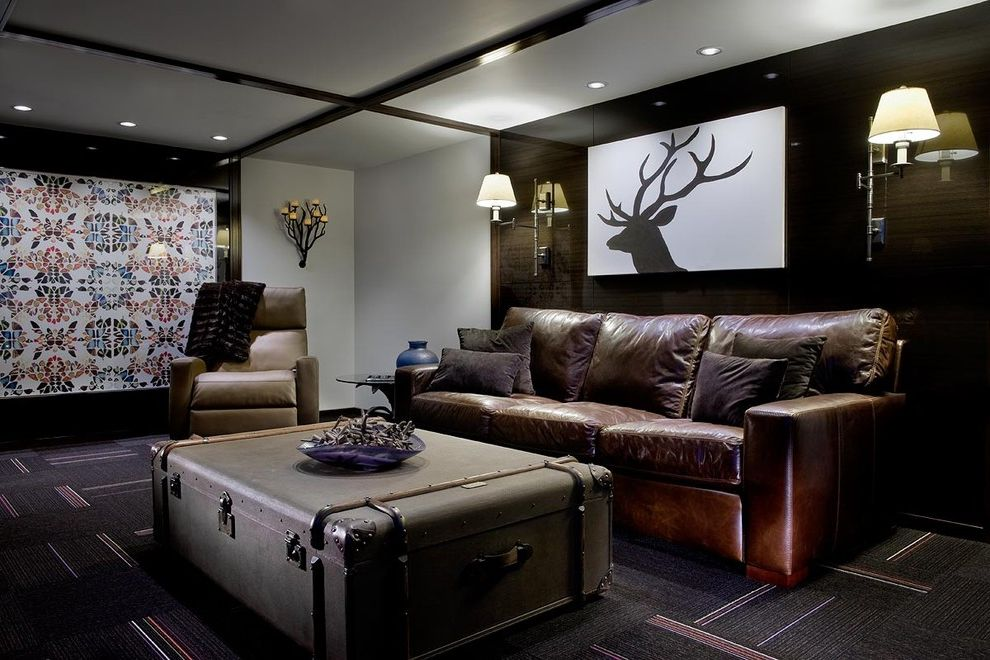 Deer Creek Storage with Eclectic Basement  and Butterfly Art Carpet Tile Ceiling Trim Coffee Table Trunk Dark Paneled Walls Iron Candle Wall Sconces Leather Couch Man Cave Reading Lights Silhoutte Deer Art Wall Mounted Lamps