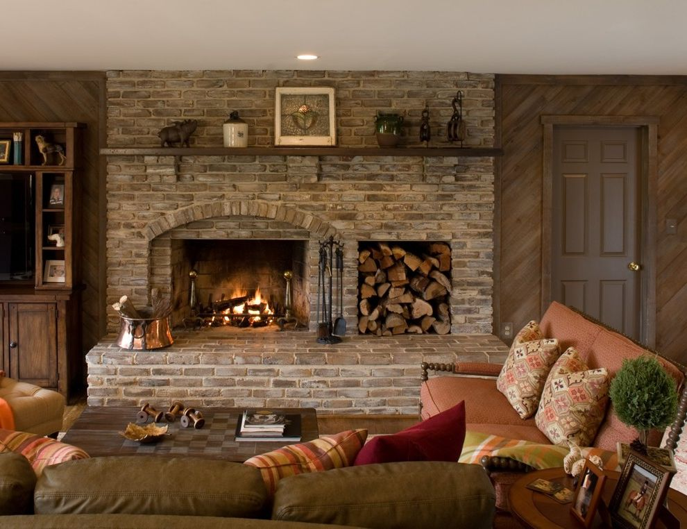 Deer Creek Storage with Traditional Family Room  and Brick Copper Bucket Fireplace Fireplace Tools Large Hearth Leather Sofa Log Storage Mantel Peach Throw Pillows Wood Wall