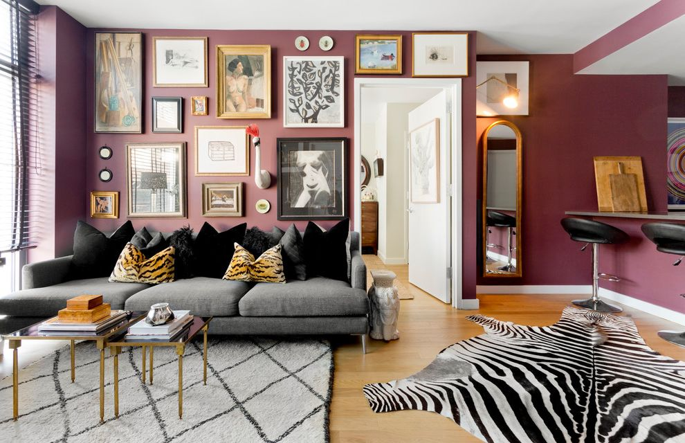 Define Arrange   Eclectic Living Room  and Animal Hide Rug Animal Prints Black Pillows Gallery Wall Grey Sofa Mismatched Frame Sizes Purple Wall Art Wall Mirror