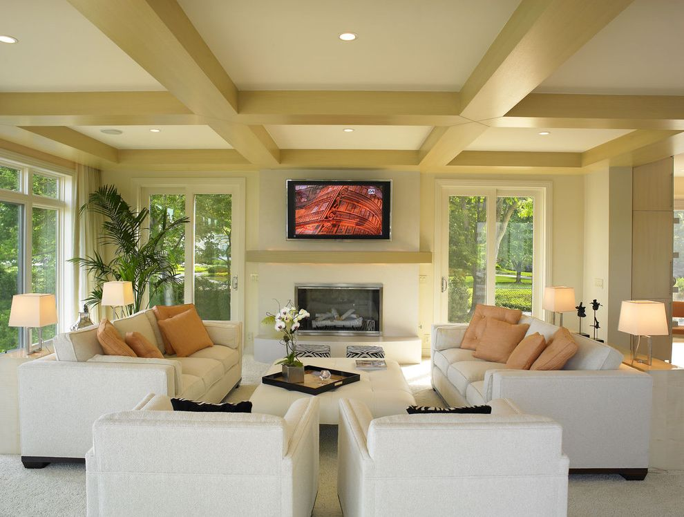 Define Arrange With Modern Living Room Also Arm Chairs Blonde Carpeting Coffered Ceiling Fireplace Mantel Muted