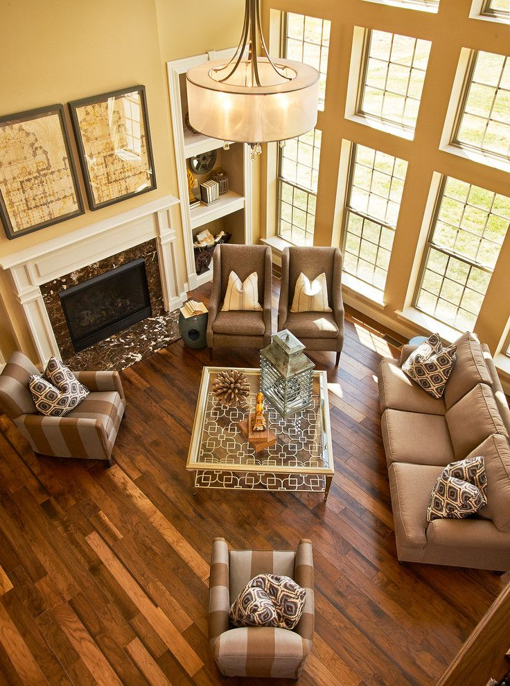 Define Arrange with Traditional Living Room Also Beige Built Ins Coffee Table Fireplace Lantern Mantel Marble Pillows Striped Upholstery Tall Windows Wood Floor