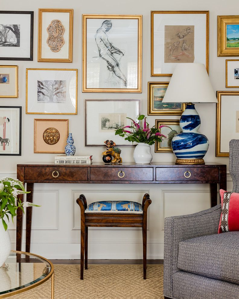 Define Arrange with Transitional Family Room  and Artwork Blue Table Lamp Boston Cape Chair Rail Console Table Contemporary Gallery Wall Gold Frames Ikat Stool New England Tweed Armchair Vase Wainscoting Wall Art