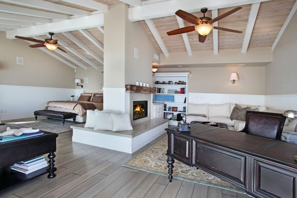 Define Hearth   Beach Style Bedroom  and Area Rug Bench Seating Cathedral Ceiling Ceiling Beams Ceiling Fan Craftsman Architecture Decorative Pillows Desk Exposed Beams Fireplace Neutral Colors Open Shelves Sconces Sectional Sofa Traditional Wood Floors