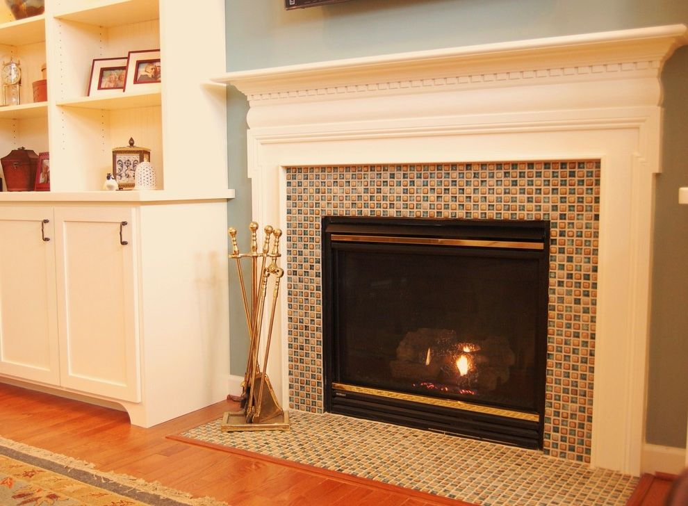 Define Hearth with Traditional Family Room  and Accent Color Blue Built in Cabinetry Family Room Glass Tile Fireplace Surround Interior Architecture
