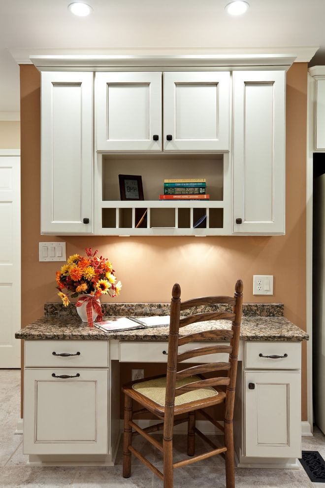 Desk Height Base Cabinets   Traditional Kitchen  and Ceiling Lighting Floral Arrangement Granite Countertops Kitchen Desk Recessed Lighting Under Cabinet Lighting White Cabinets White Wood Wood Cabinets Wood Trim