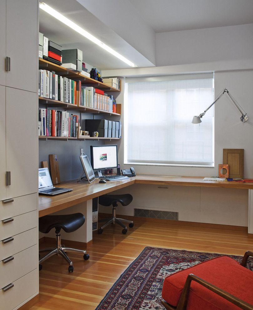 Desk with Shelves Above with Contemporary Home Office and Area Rug Built in Desk Built in Desk Ceiling Lighting Oriental Rug Shared Workspace Swing Arm Lamp Tube Light Wall Mount Lamp Wall Shelves Window Treatments Wood Flooring Wooden Desk