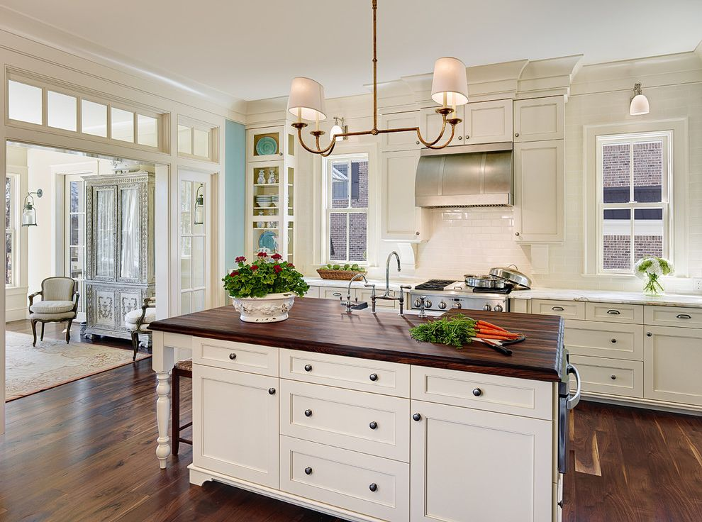 Difference Between Queen and Full with Traditional Kitchen  and Crown Molding Island Lighting Kitchen Island Range Hood Transom White Trim Wood Floors