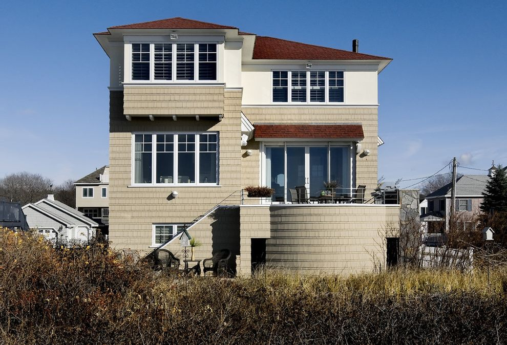 Different Color Wood Floors   Beach Style Exterior Also Architects Nh Bay Window Beach Home Coastal Home Coastal New England Coastal New Hampshire Contemporary Home Hampton Nh Patio Door Round Terrace Shingle Style Home