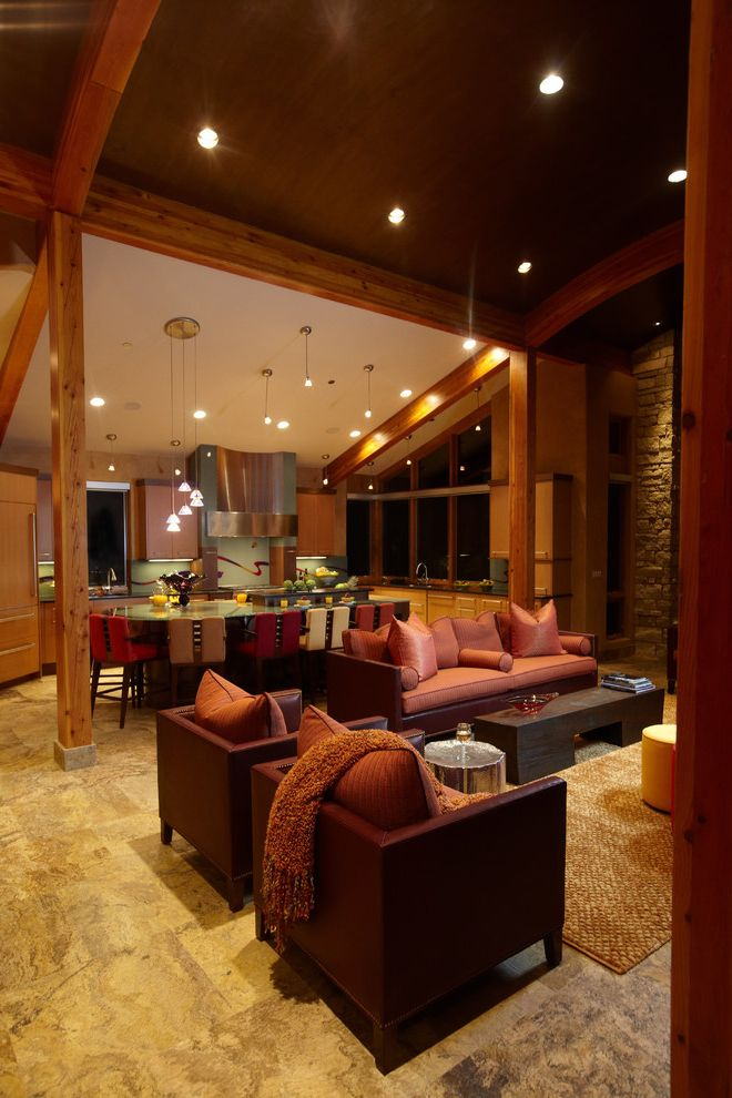 Different Color Wood Floors   Contemporary Living Room  and Counter Stools Dark Stained Wood Hood Kitchen Pendant Lights Pillows Recessed Lights Red Seating Area Side Table Stainless Steel Stone Wall Tile Floor Wood Ceiling Woven Area Rug