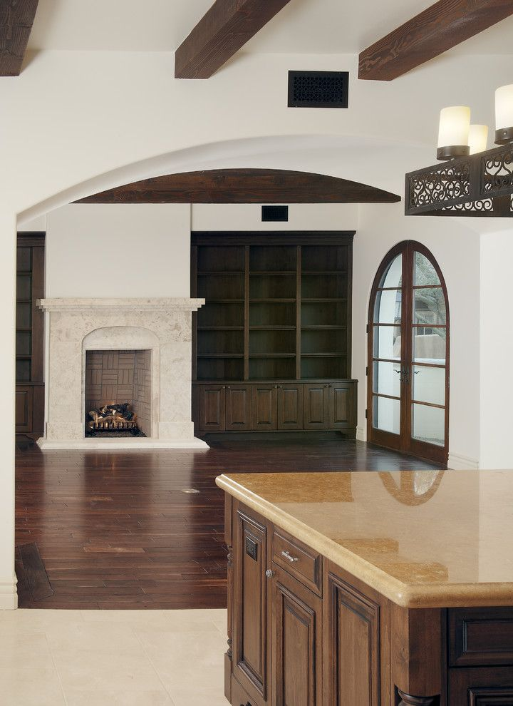 Different Color Wood Floors   Mediterranean Spaces  and Bookcase Bookshelves Built Ins Dark Floor Exposed Beams Fireplace French Doors Glass Doors Great Room Kitchen Kitchen Island Shelving Stone Fireplace Wood Flooring