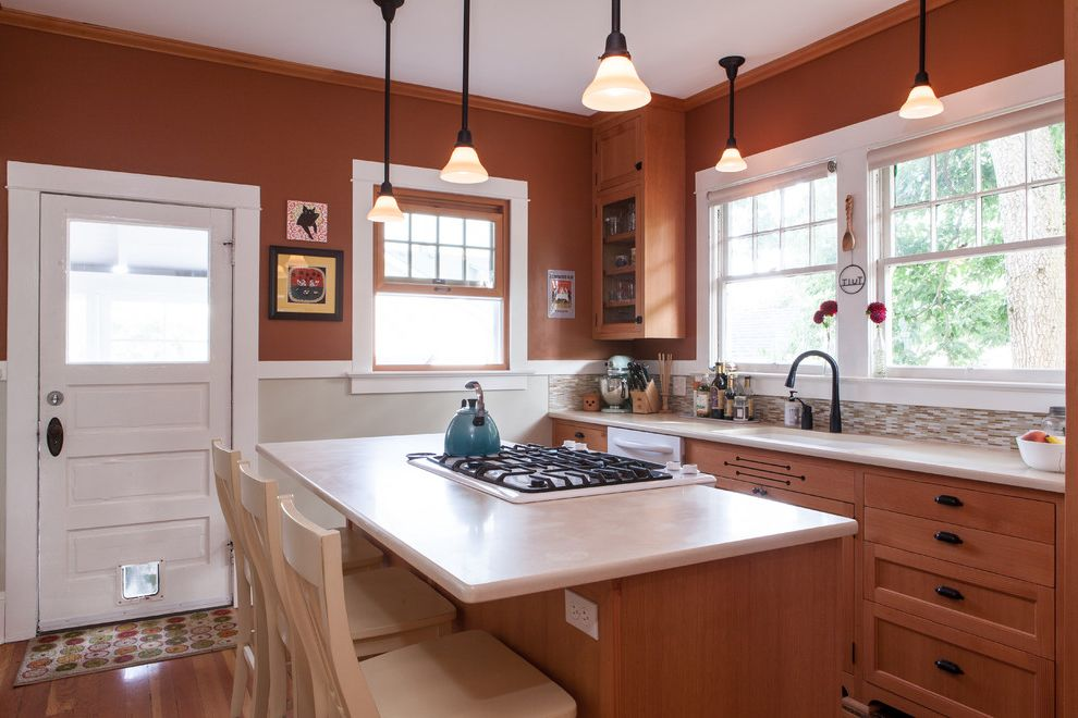 Different Color Wood Floors   Traditional Kitchen  and Carmel Counter Stools Country Double Hung Windows Kitchen Island Pendant Lights Small Kitchen Tile Backsplash White Painted Wood Trim Wood Floor