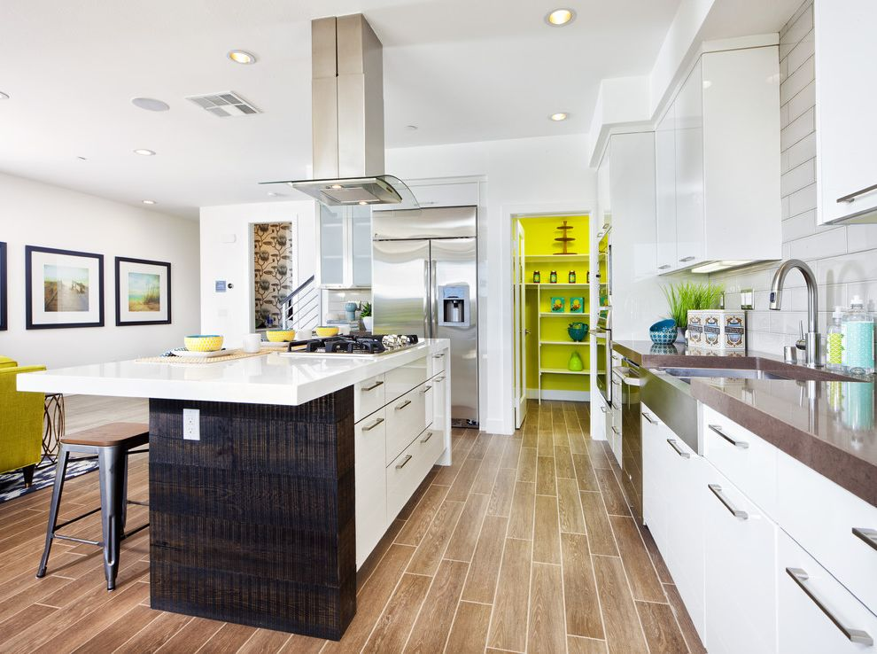 Different Color Wood Floors with Contemporary Kitchen Also Beach Living Brown Countertop Contemporary Design Costa Mesa Metal Bar Stools New Construction Recessed Lighting Urban Style White Countertop