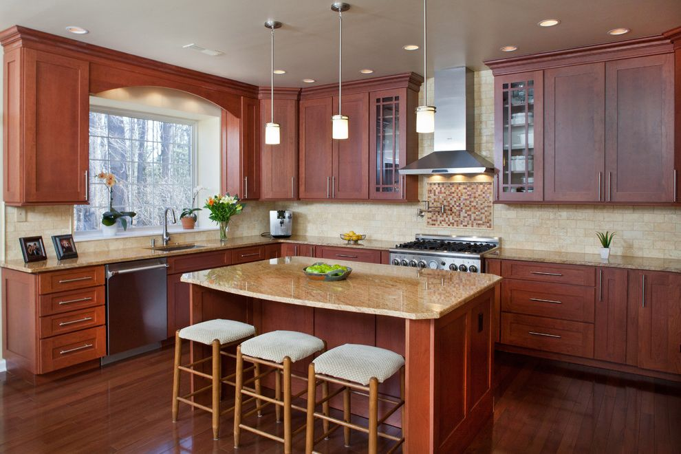 Different Color Wood Floors with Traditional Kitchen  and Breakfast Bar Eat in Kitchen Gerhard Appliances Island Lighting Kitchen Island Pendant Lighting Pot Filler Range Hood Stainless Hood Stainless Range Stainless Steel Appliances Wood Floors