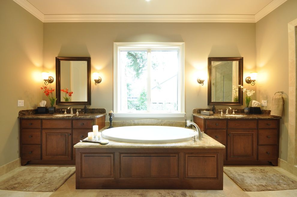 Different Colors of Granite with Traditional Bathroom Also Bath Mat Crown Molding Double Sinks Double Vanity Sconce Soaking Tub Tub Surround Wall Lighting White Wood Wood Cabinets Wood Trim