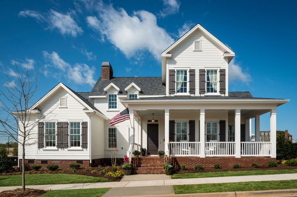 Dillard Jones Builders with Traditional Exterior  and Black Door Black Front Door Black Shutters Front Entrance Porch Shingle Standing Seem Tin Roof White Exterior Wood Exterior