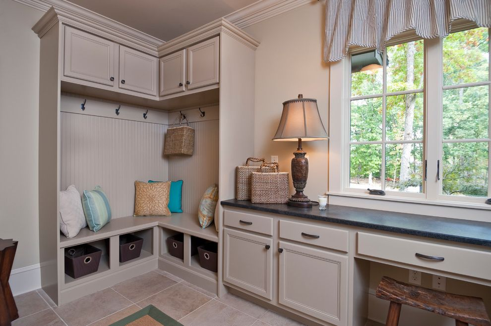 Dillard Jones Builders with Traditional Laundry Room  and Basket Storage Baskets Beadboard Beige Built in Bench Seat Casement Windows Coat Hooks Cubbies Pillows Pinstripe Stool Table Lamp Tile Floor Valance
