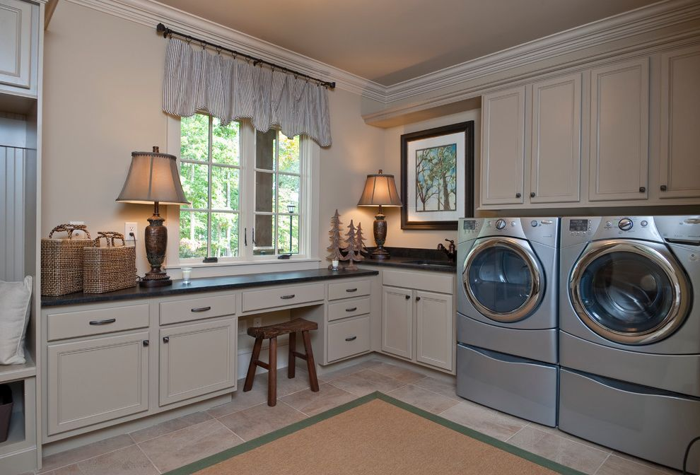 Dillard Jones Builders with Traditional Laundry Room  and Basket Storage Baskets Beige Black Counter Built in Bench Seat Casement Windows Coat Hooks Cubbies Green Border Natural Fiber Pinstripe Stool Table Lamp Tile Floor Valance