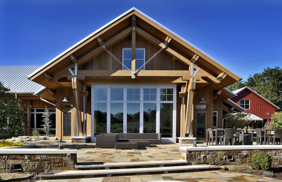 Dillons Beach   Farmhouse Exterior  and Barn Beam Exposed Beams Large Window Large Windows Outdoor Living Area Patio Stone Stone Patio Stone Wall Tin Roof