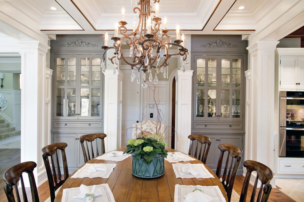 Dining Set with China Cabinet   Traditional Dining Room  and Built I Cabinets Chandelier China Cupboards Coffered Ceiling Columns Crystals Dining Table Frame and Panel Woodwork Gray Painted Cabinets Oval Table Spindle Chairs