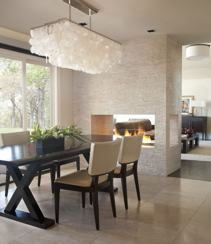 Direct Buy Denver   Contemporary Dining Room Also Ceiling Light Chandelier Dark Stained Wood Dining Area Dining Chairs Dining Table Neutral Colors Open Fireplace Seating Area Stone Walls Tall Window Three Sided Fireplace Tile Floor Trestle Table